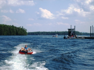 Adam on Winnipesaukee; barge hauling a deck on right